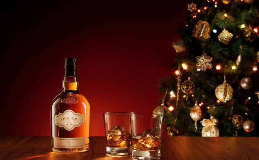 Whisky bottle and two glasses with Christmas tree